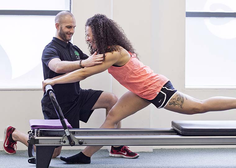 Neil Dimmock Ten Head of Fitness teaching Reformer Pilates