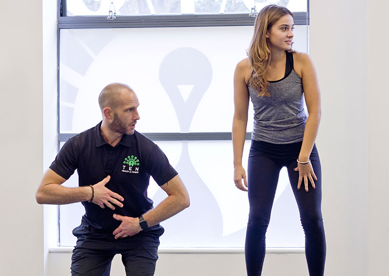 Neil Dimmock Ten Head of Fitness teaching Reformer Pilates for TenEducation